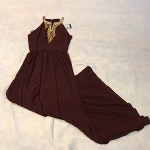 Plum color gown with good necklace